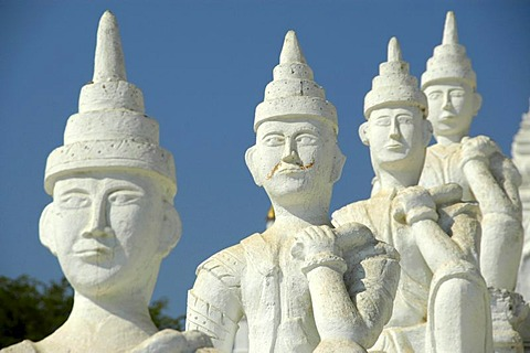 White figurines in a row, one below and in front of the other at a Buddhist temple, Mingun, near Mandalay, Burma, Myanmar, Southeast Asia