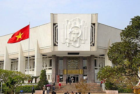 National Museum with the Vietnamese national flag and socialist symbols star, hammer and sickle, Hanoi, Vietnam, Asia