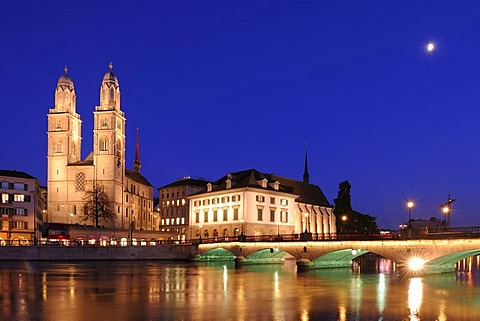 Grossmuenster Church and Helmhaus Zuerich by night, Zuerich, Switzerland, Europe