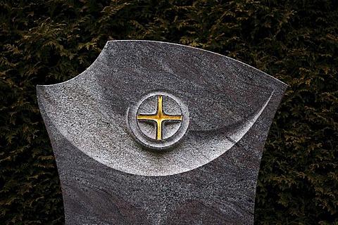 Masonry art work, cross on a gravestone