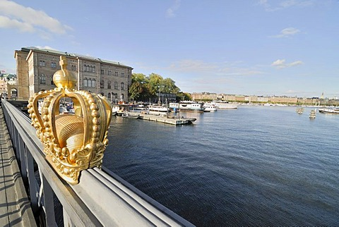 Golden Swedish crown on the handrail of a bridge, Stockholm, Sweden, Scandinavia, Europe