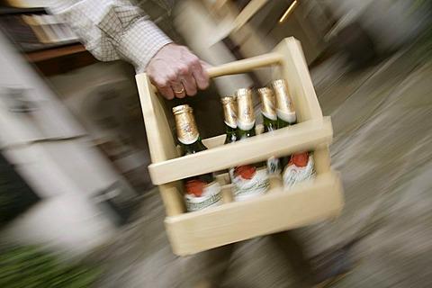Beer bottles with Pilsner Urquell beer of the Pilsner Brewery in a wooden container, Pilsen, Plzen, Bohemia, Czech Republic, Europe.