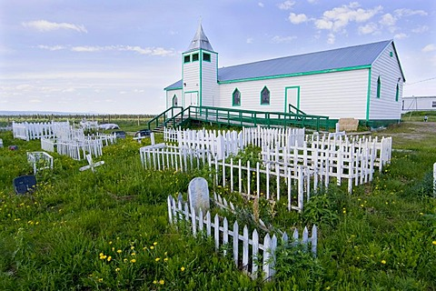 Historic graveyard and wooden church in Fort McPherson, Lost Patrol, arctic village, Northwest Territories, Canada, North America