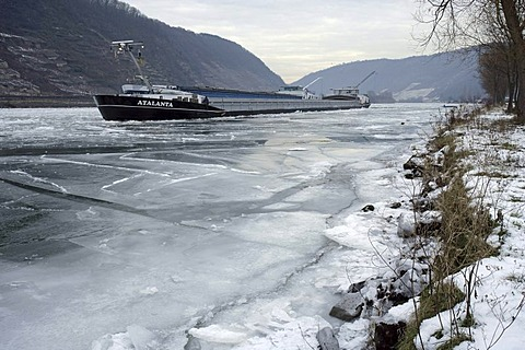 River barges stuck in ice on the river Mosel, near Oberfell, Rhineland-Palatinate, Germany, Europe