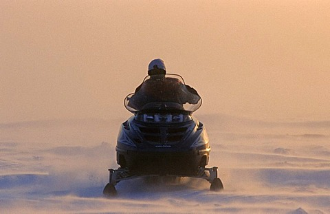 Inuit driving a snowmobil, Nuiqsut, on the coast of the Arctic Ocean in the far north of Alaska