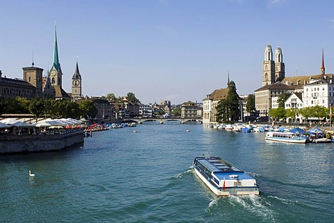Limmat River, historic center of Zurich, looking onto the Fraumuenster abbey, the Peterskirche, or St. Peter's Church, and the twin towers of the Grossmuenster Church the symbol of the city, Zurich, Switzerland, Europe