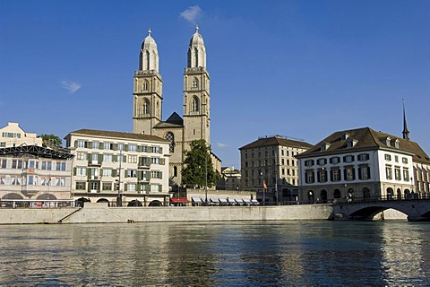 Limmat River in front of the twin towers of the Grossmuenster Church, the symbol of the city of Zurich, Switzerland, Europe
