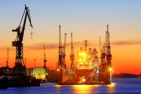 Ship in a dock of the Blohm and Voss shipyard in the port of Hamburg in evening light, Elbe River, Hamburg, Germany, Europe