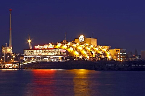 """Theatre for the musical """"The Lion King"""", at night in the free port of Hamburg on the Elbe River, Hamburg, Germany, Europe"""
