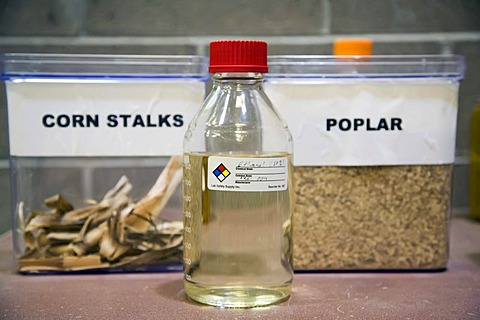 A bottle of ethanol and some of the materials ethanol can be made of at the National Renewable Energy Laboratory, operated by the US Department of Energy, where scientists are developing economical processes for making cellulosic ethanol from non-edible p