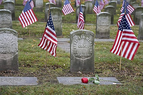 A Veterans Day ceremony at Elmwood Cemetery honors members of the 102nd U.S. Colored Infantry Regiment who fought in the American Civil War, Detroit, Michigan, USA