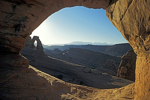 Delicate Arch, left, and the distant La Sal Mountains, framed by another small arch, Arches National Park, Utah, USA