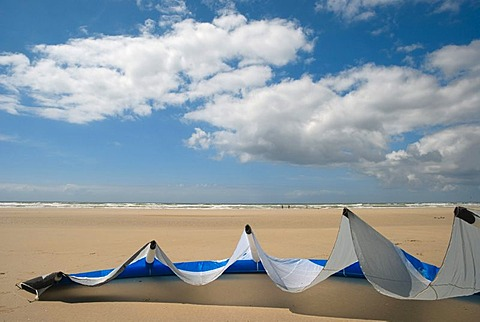 Kite sail lying on the sand of a beach in Brittany, France, Europe