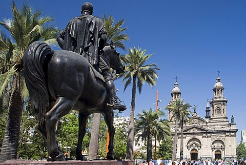 Equestrian sculpture and cathedral, Plaza de Armas, Santiago de Chile, Chile, South America