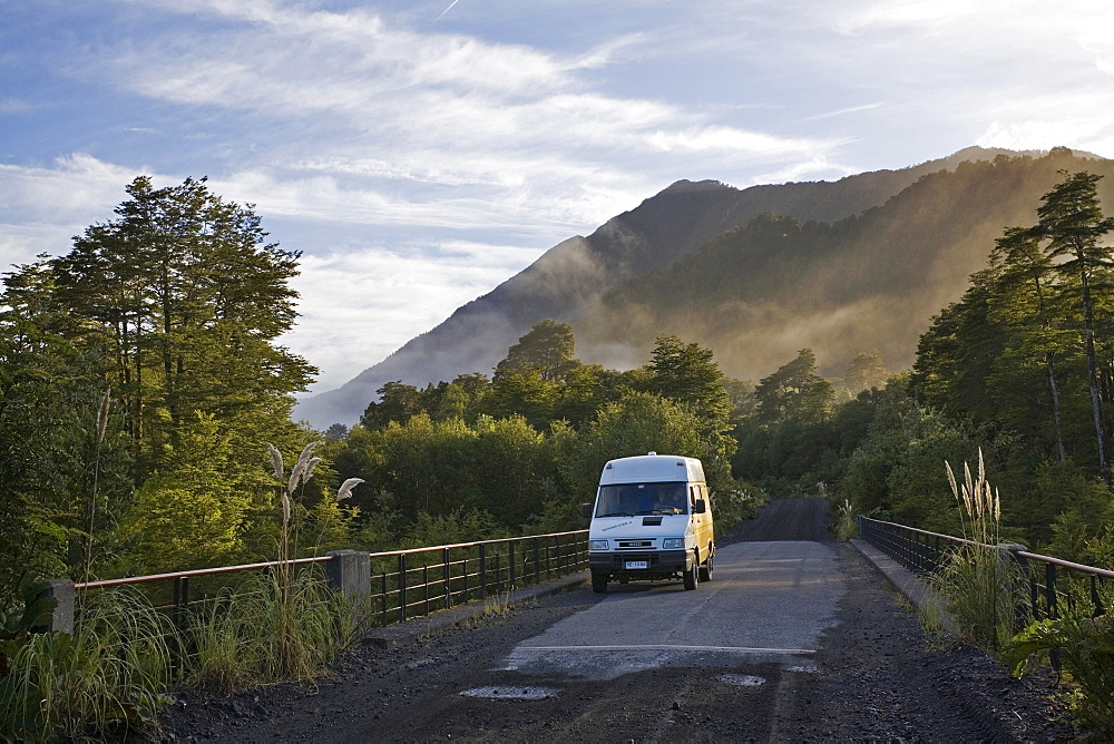 Camper on a bridge at Park Pumalin, Carretera Austral, Patagonia, Chile, South America