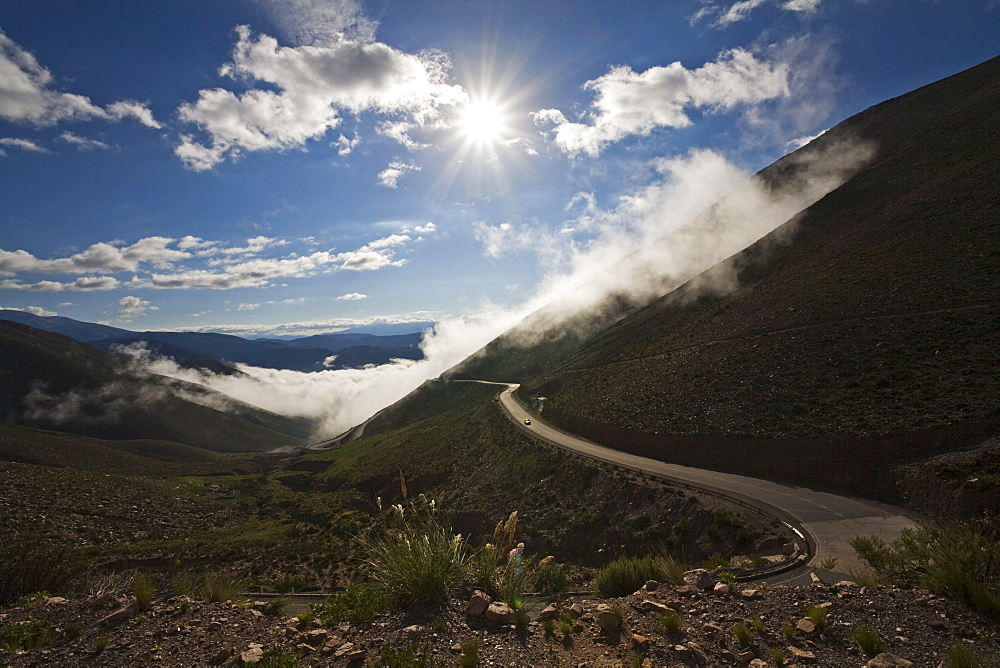 Pass road across the Andes through the clouds and fog, direction Jama pass (Paso de Jama), Argentina, South America