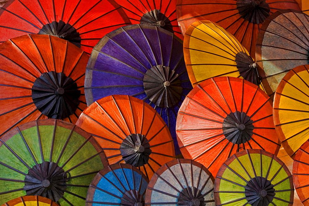 Various hand-made coloured paper umbrellas