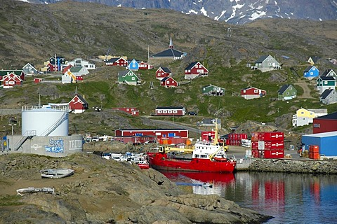 Vista of the city with port ship and colourful houses Ammassalik Eastgreenland