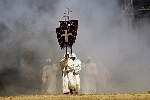 Monks in white cowls carries red flags with cross are befog, knight festival Kaltenberger Ritterspiele, Kaltenberg, Upper Bavaria, Germany - 832-280392