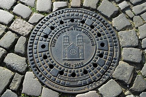 Drain cover with city coats of arms, Muenster, North Rhine-Westphalia, Germany