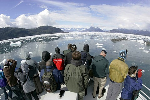 Tourist on a boat look amazed at the icebergs of the Columbia glacier Prince Williams Sound Alaska USA