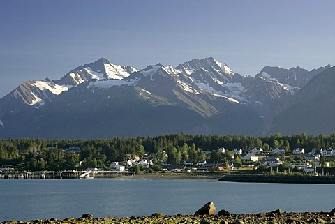 View of the village of Haines surronded by mountains and situated at the sea Alaska USA