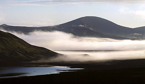 View from the Ljotipollur volcano over black lava sand fog Iceland