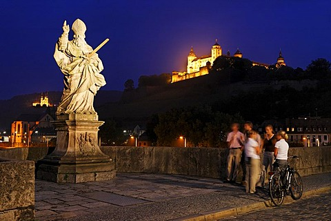Fortress Marienberg and a statue of St.Kilian on the old bridge over the Main river, Wuerzburg, Bavaria, Germany