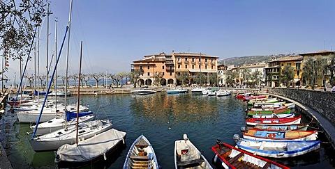Harbour with sailing ships and small fishing boats, Torri del Benaco, Garda lake, Italy