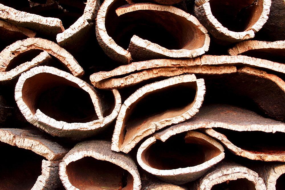Detail cork oak stacks for drying material Monchique Algarve Portugal