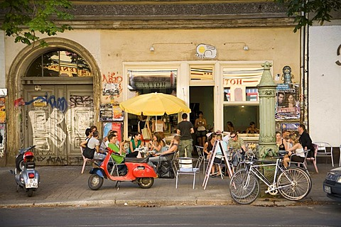 Typical Prenzlauer Berg street scene: street cafe at Kastanienallee, Berlin, Germany, Europe