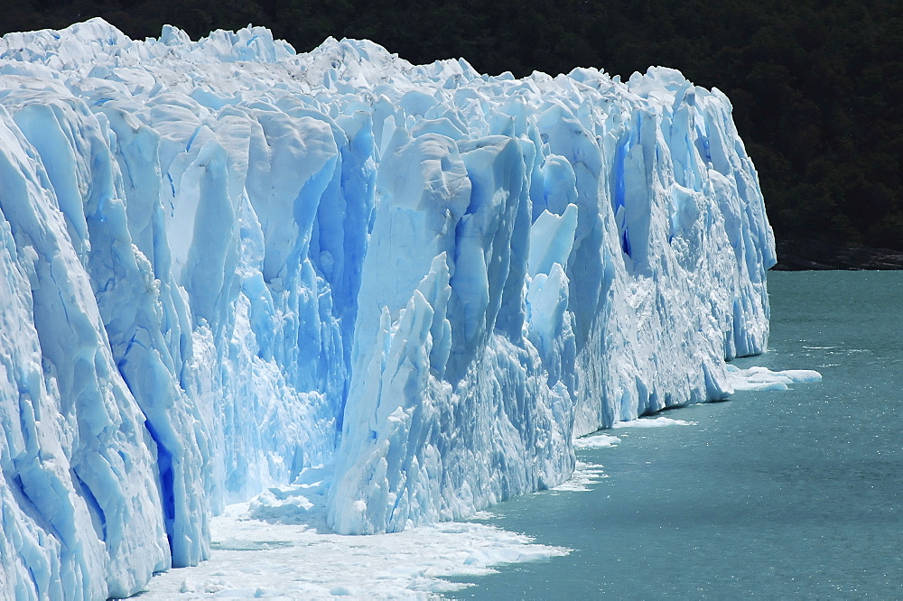 Deep blue ice of the cracking Perito Moreno Glacier, Patagonia, Argentina
