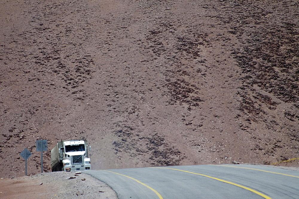 Truck driving along the road of Jama pass, Chile, South America