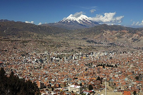 La Paz with Mt. Illimani behind, seen from El Alto, Bolivia, South America