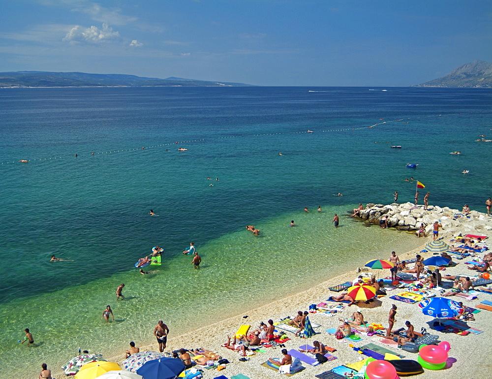 Beach Full of Holiday Makers on Vacation Next to the Adriatic Sea, Baska Voda, Dalmatian Coast, Croatia, Europe.