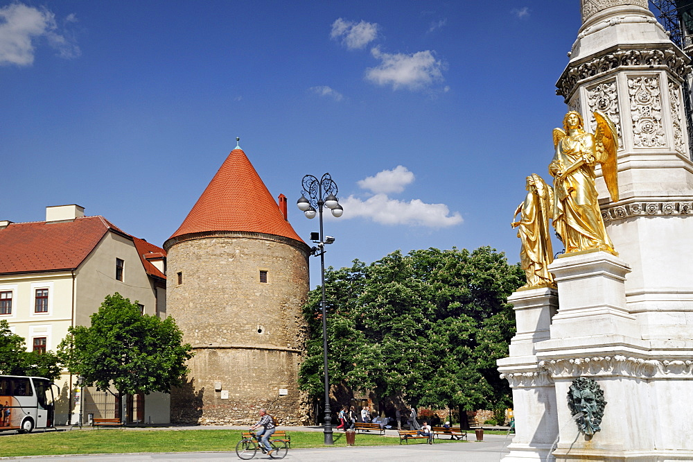 Golden statues of angels and old fortifications in the medieval old town of Kaptol, Zagreb, Croatia, Europe