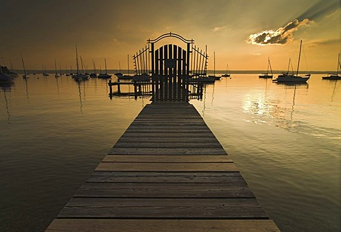 Sunset over a pier in Herrsching on Lake Ammersee, Bavaria, Germany, Europe