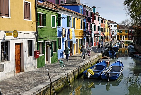 Colourfully painted houses along a canal on Burano, an island in the Venetian Lagoon, Italy, Europe