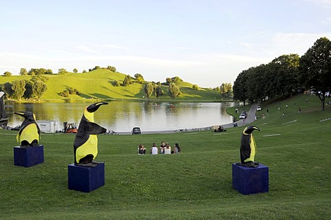 View of the Olympiasee Lake in the foreground sculptures of penguins, Olympia Park, Munich, Bavaria, Germany, Europe