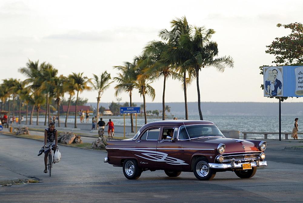 Vintage car driving, Malecon, Cienfuegos, Cuba, Americas