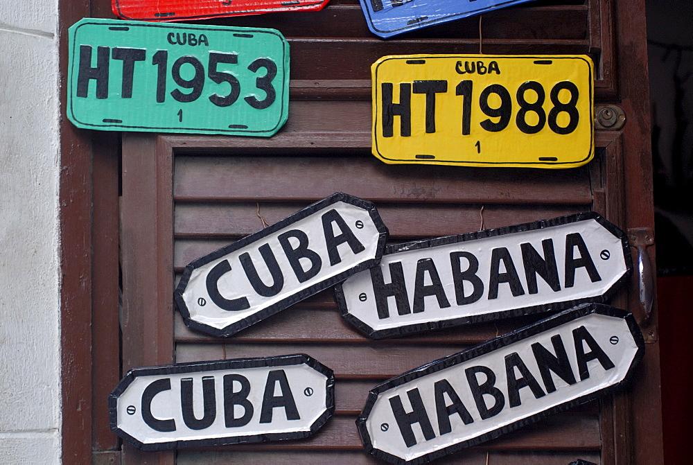 Souvenirs, licence plates and door signs, Havana, Cuba