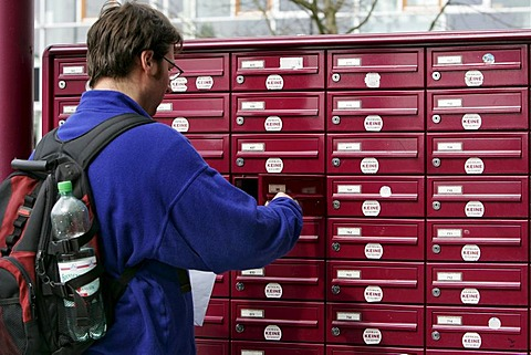 Man takes his letters out of the mail box