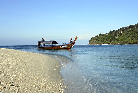 Longtail boat and sandy beach of the island Koh Adang inside Tarutao National Park - Andaman Sea , Thailand, Asia