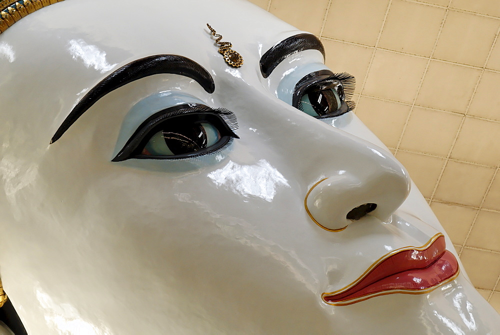 Buddha face (closeup) in Kyaukhtatkyi Pagoda, Yangon (Rangoon), Myanmar (Burma)
