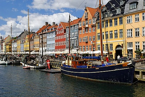 Historic boats in front of a row of apartment houses in the Nyhavn, Copenhagen, Denmark, Scandinavia, Europe