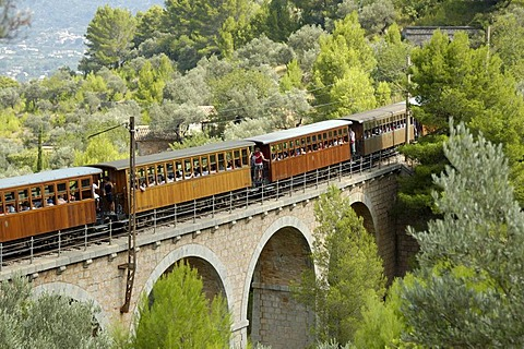 "Historic railway train ""red flash"" on bridge, Soller, Majorca, Spain"