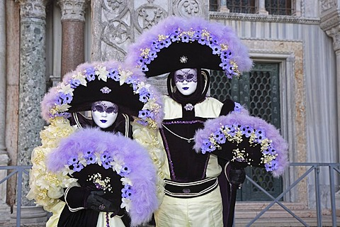 Two masks at the carnival in Venice, Italy