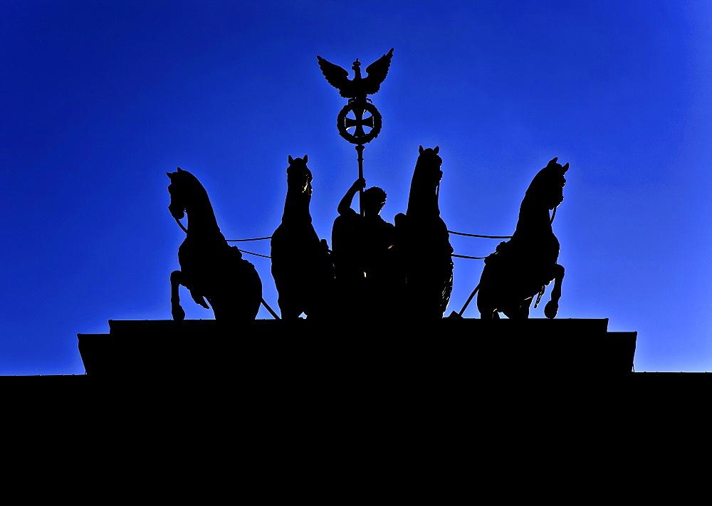 Silhouette of the quadriga on the Brandenburg Gate, Berlin, Germany
