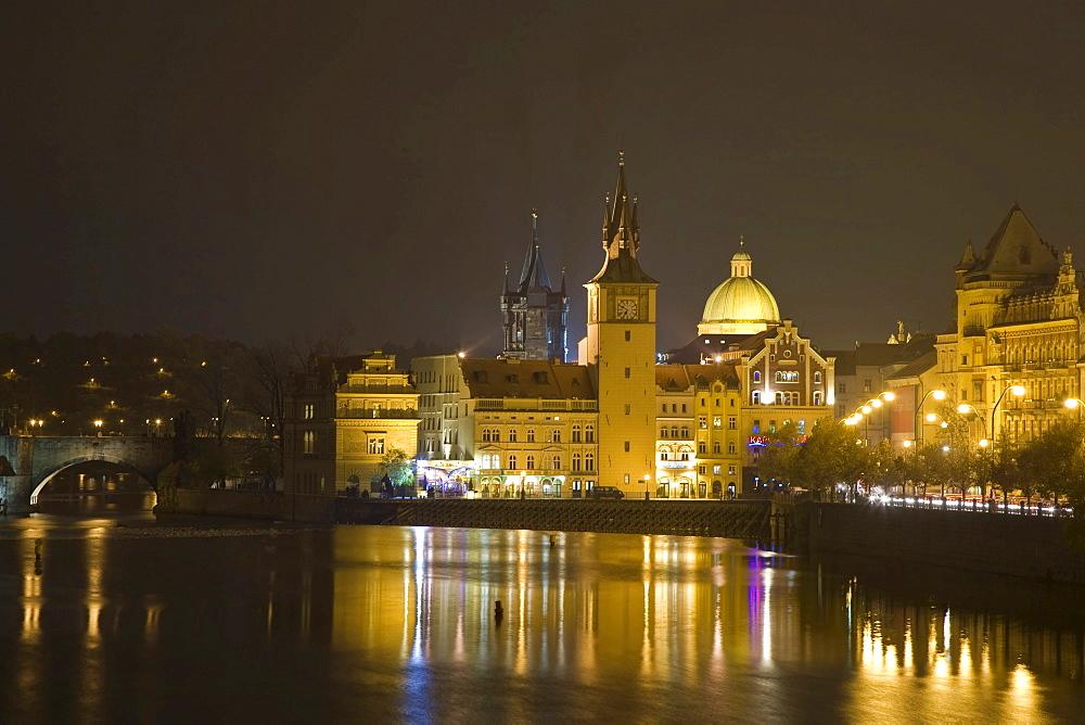Night shot Vltava waterside with Charles Bridge Prague Czechia
