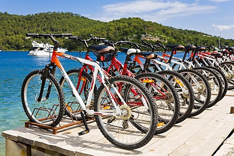 Lined up bicylces, bicycle hire in Polace, Mljet Island, Dubrovnik-Neretva, Dalmatia, Croatia, Europe